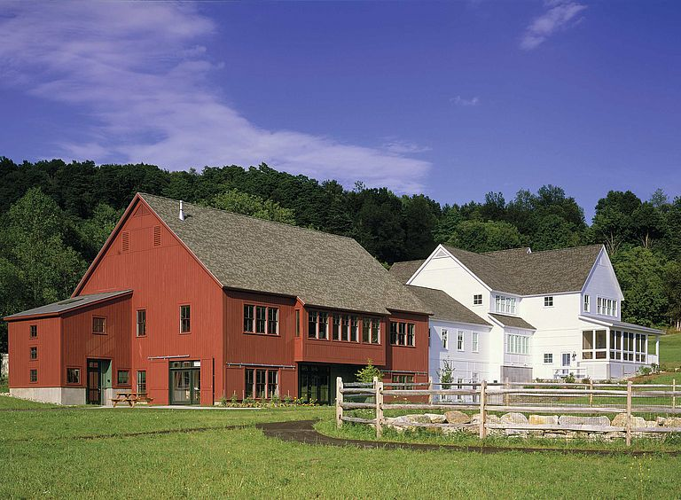 Re-purposed white farmhouse with red barn