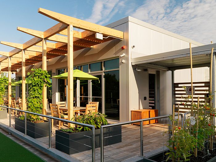 Rooftop deck with modern room and arbor