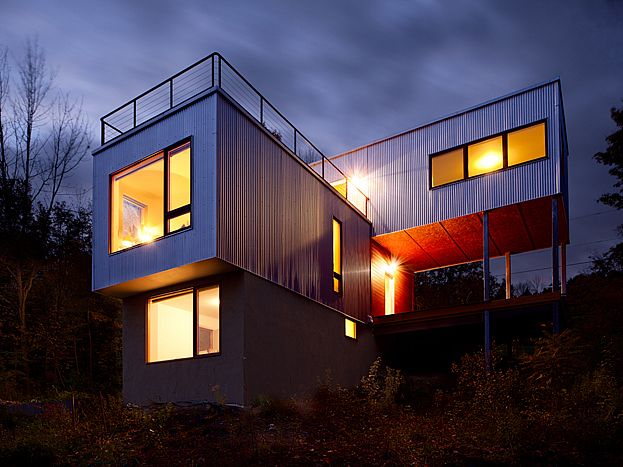House of cantilevered Steel sided rectangular blocks