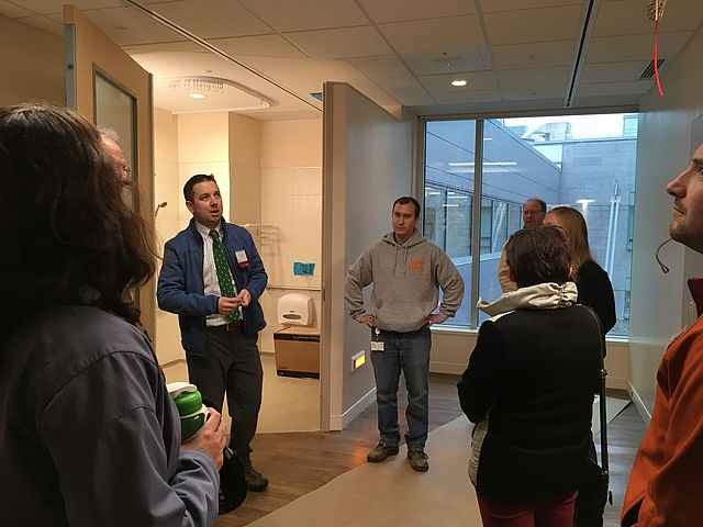 Tour guide shows hospital room