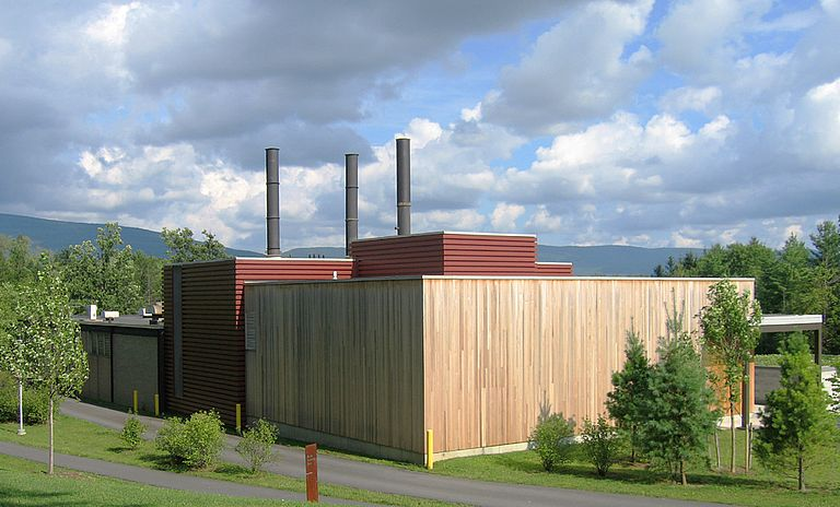 wood and horizontal metal cladding on articulated cube volumes