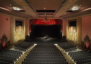 Rich, painted plaster and intracate stained glass panels adorn this restored theater interior