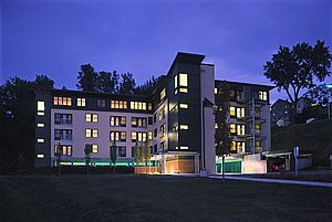 Contemporary multistory apartment building at night