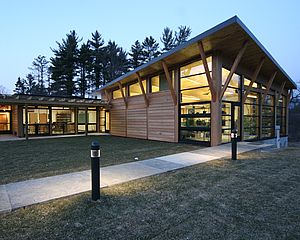 Natural wood and glass forms with bracketed roofs