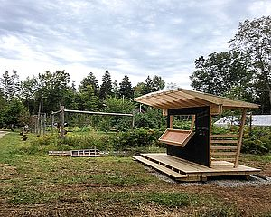 simple wood framed farm stand with expressed structure