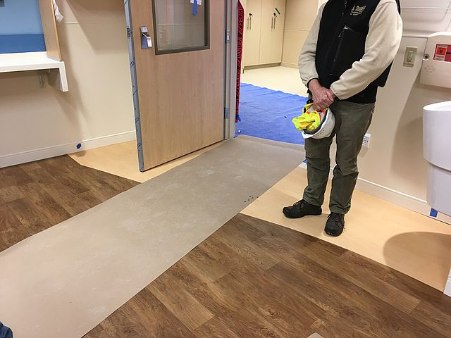 two different types of wood floor in a patient room