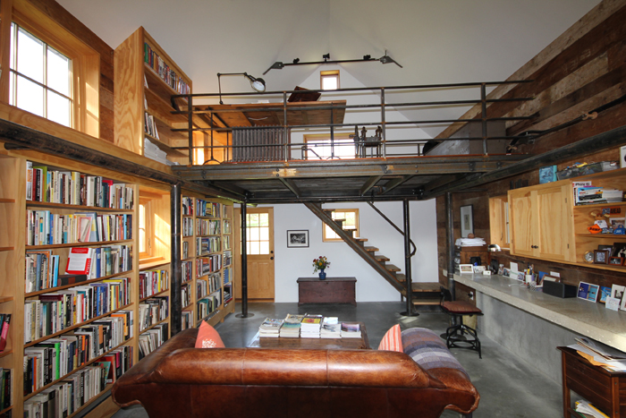 Contemporary Residential Library With Wood Shelves And Loft Study